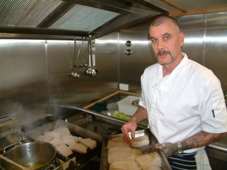 Mike cooking toothfish - you have to taste it to understand!